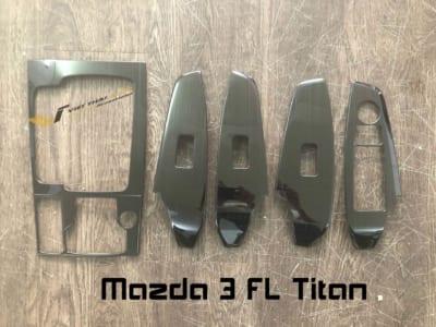 Ốp công tắc lên xuống kính titan Mazda 3